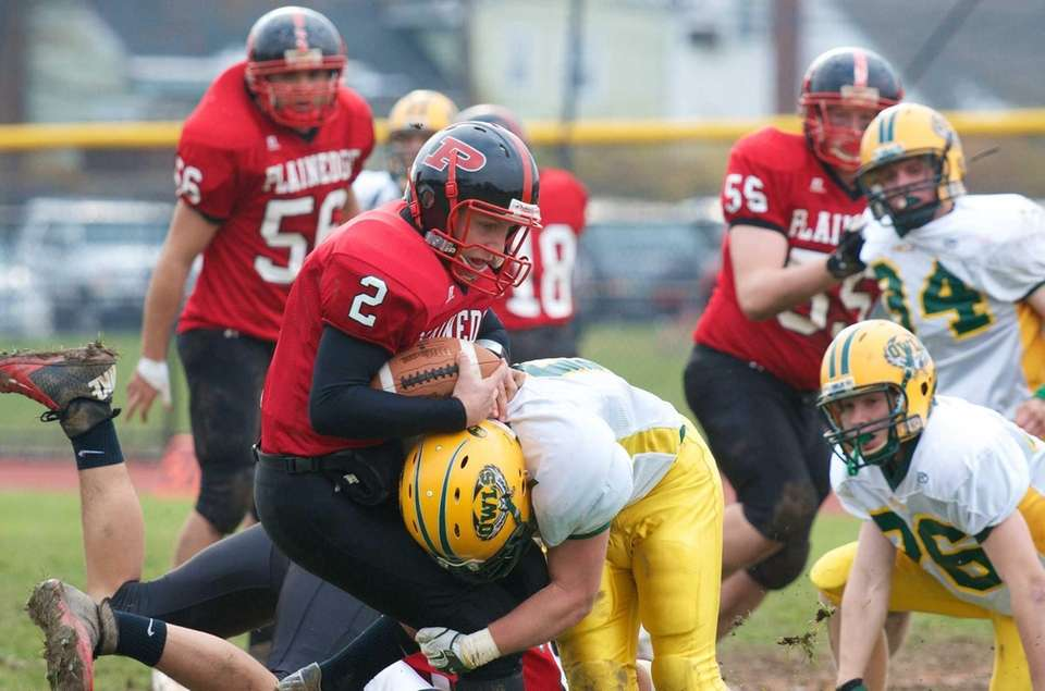 Plainedge quarterback Nick Frenger is sacked by Lynbrook