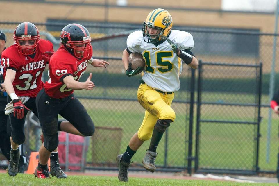Lynbrook's Joe Grossi returns a kickoff in a