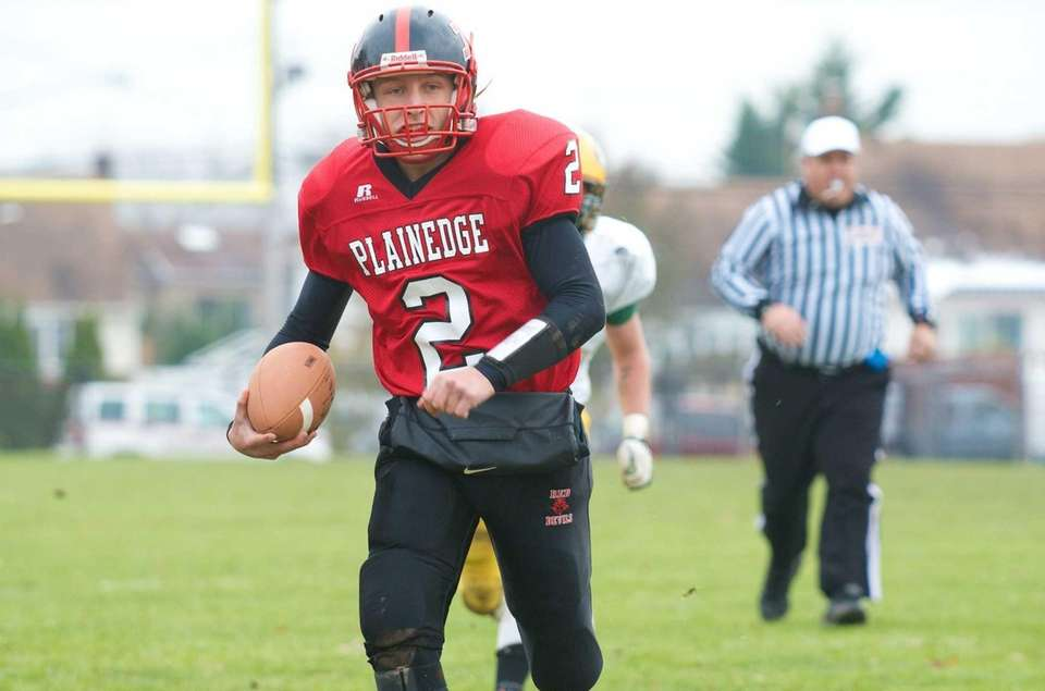 Plainedge quarterback Nick Frenger scrambles for a big