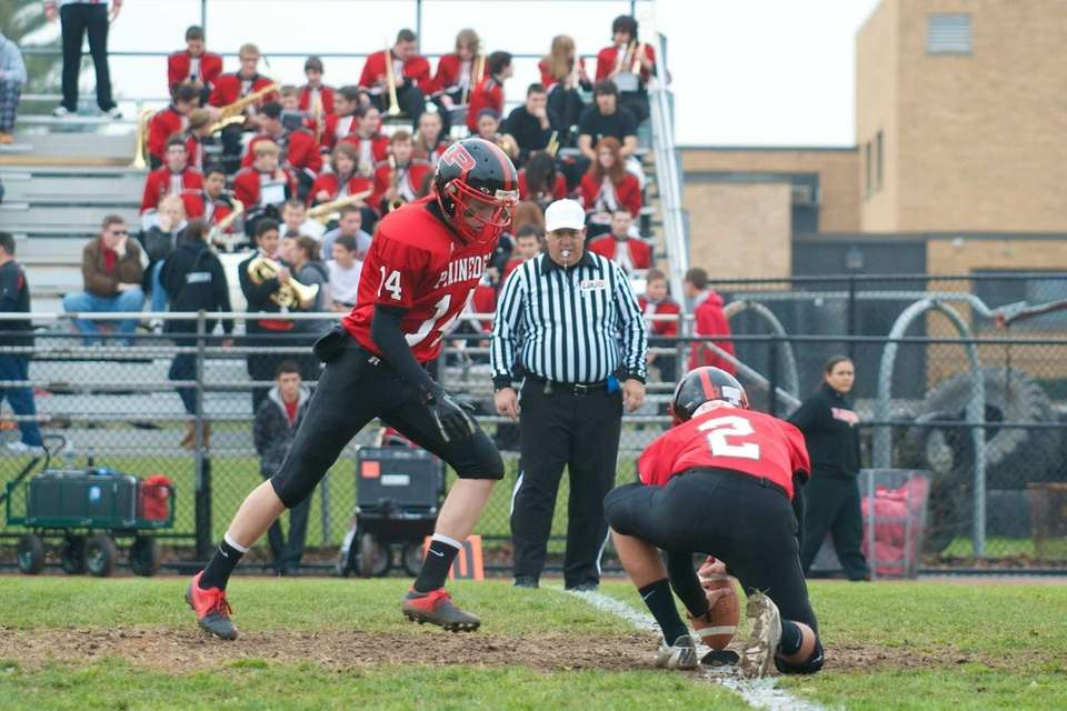 Plainedge kicker Dan Stock kicks an extra point