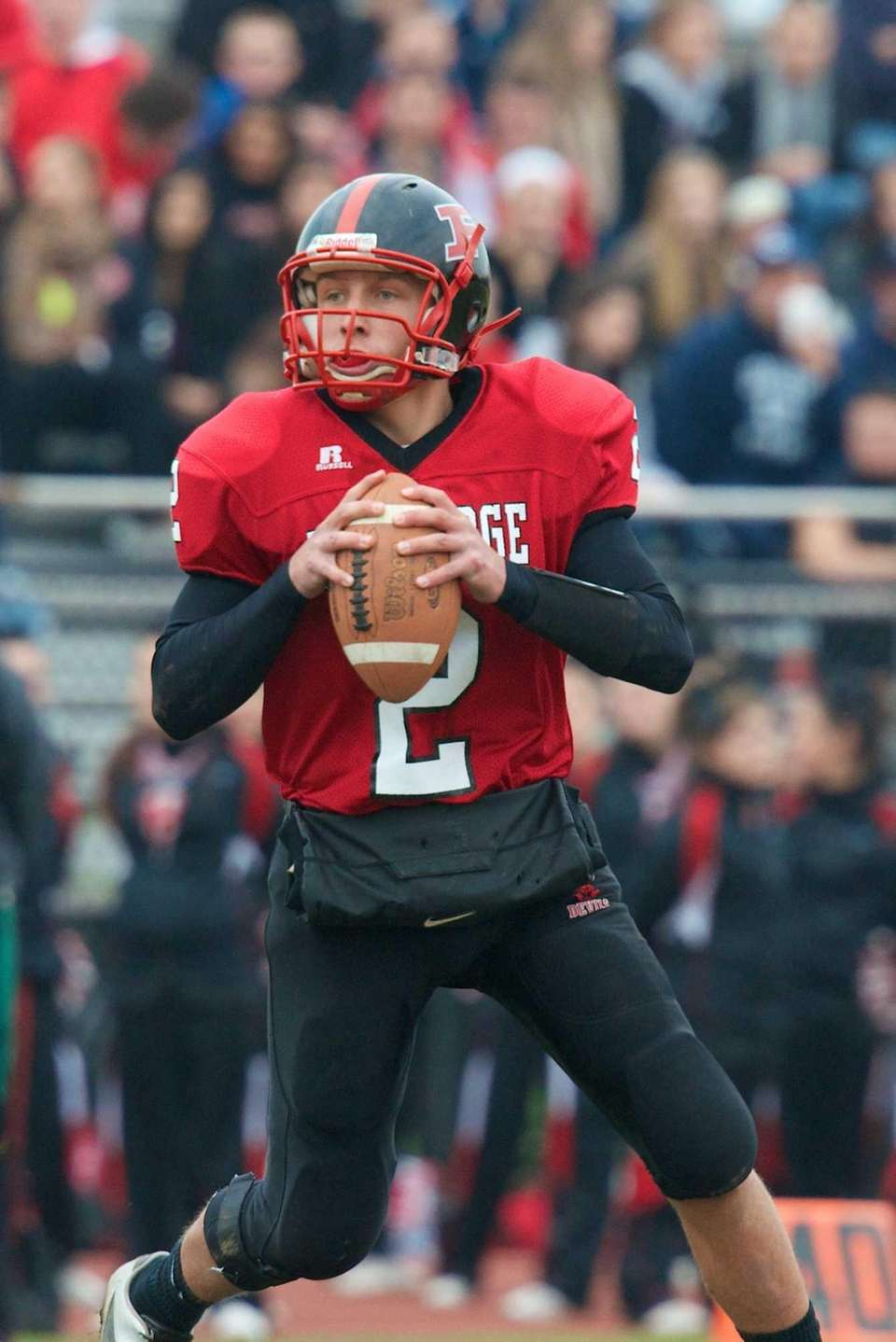 Plainedge quarterback Nick Frenger looks downfield for an