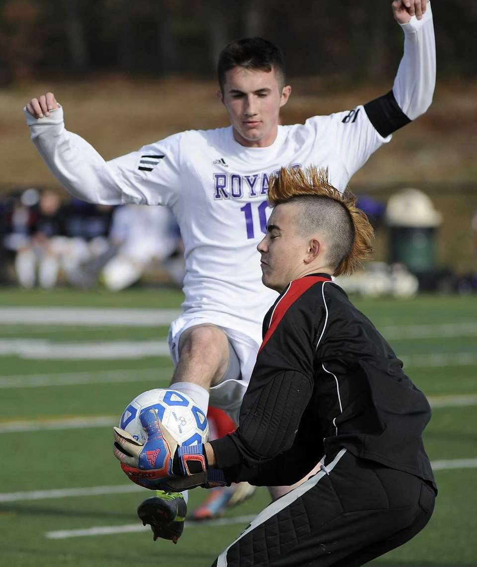 Southold goalkeeper Kenji Fujita makes a save under