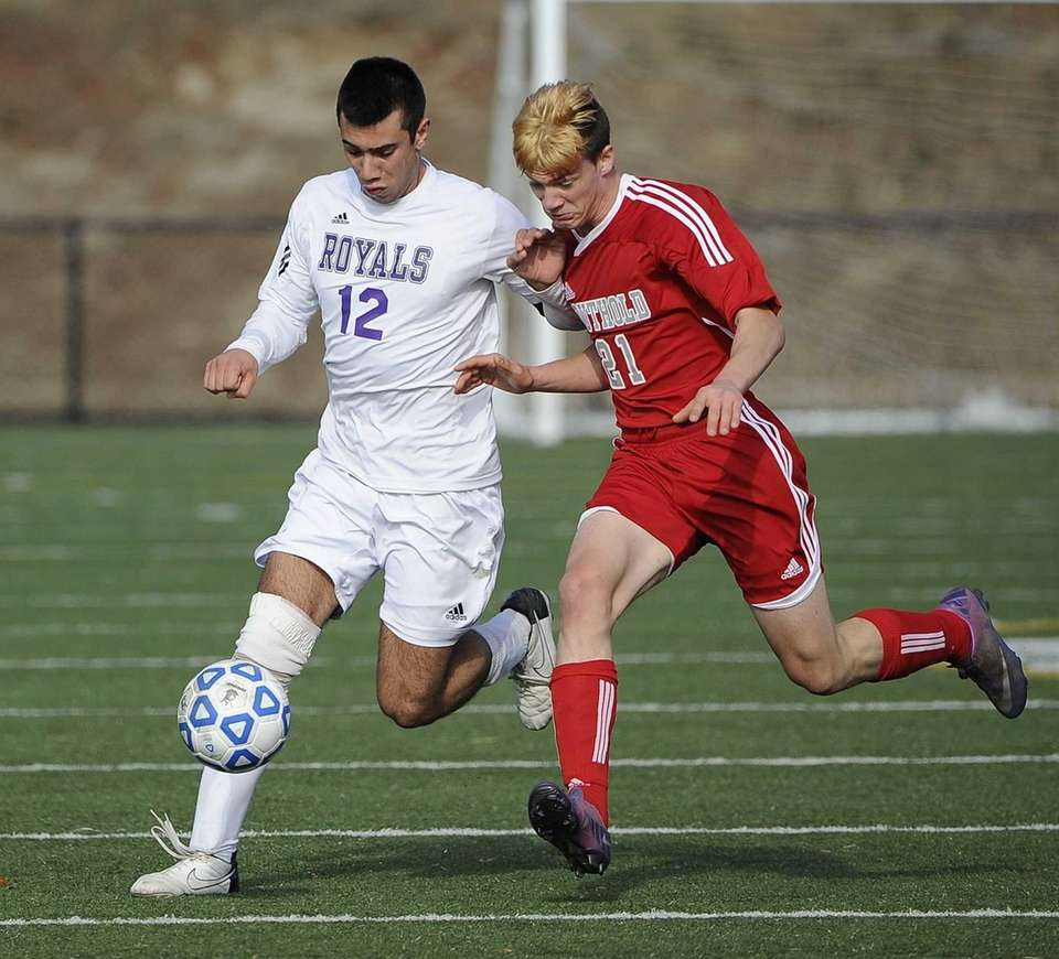 Port Jefferson's Vincent Antonelli drives the ball defended