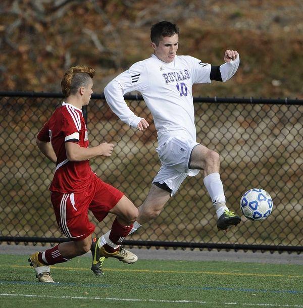 Port Jefferson's Blake Bohlen drives the ball along