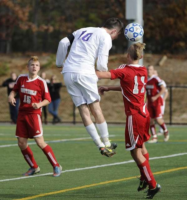 Port Jefferson's Blake Bohlen attempts to head the