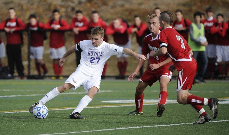 Port Jefferson's Connor Crovello controls the ball past