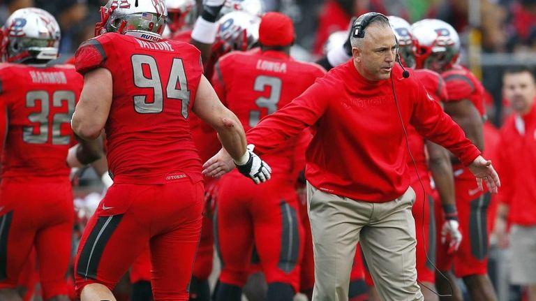 Rutgers head coach Kyle Flood congratulates Scott Vallone