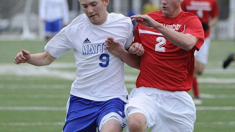 Mattituck's David Burkhardt is defended by Center Moriches'