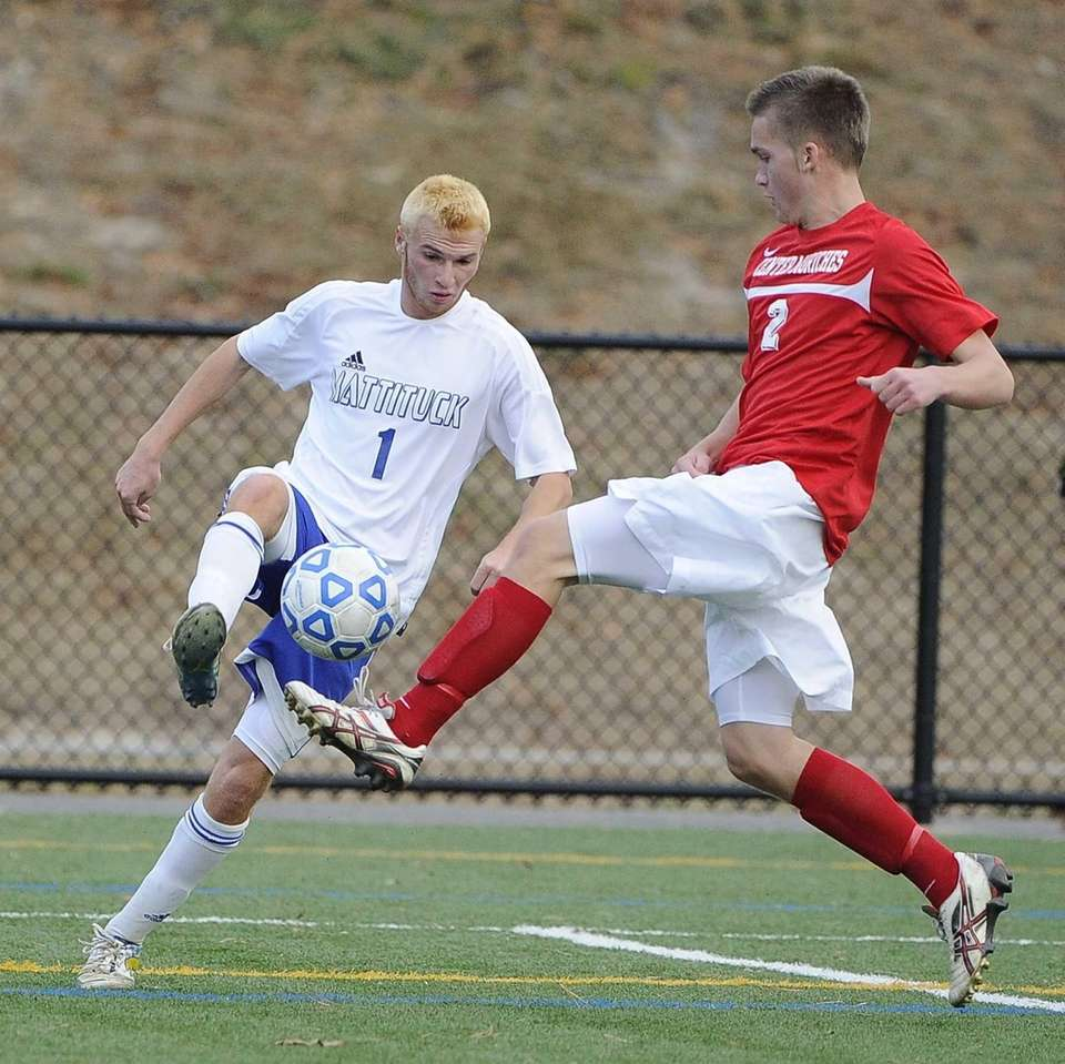Mattituck's Stephen Urwand is defended by Center Moriches'