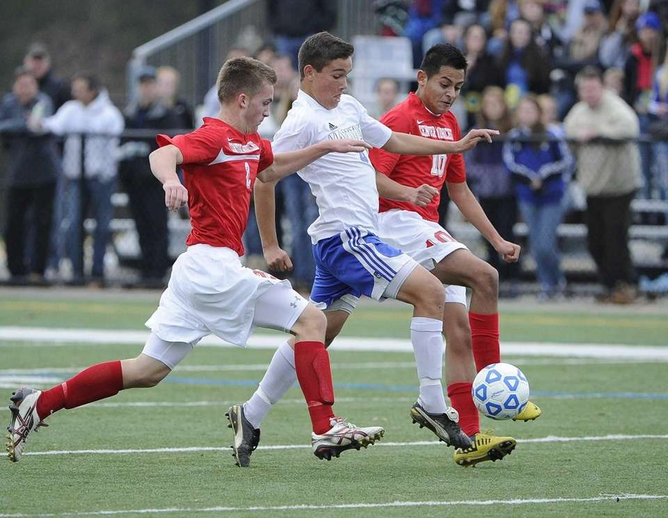 Mattituck's James Hayes drives the ball between Center