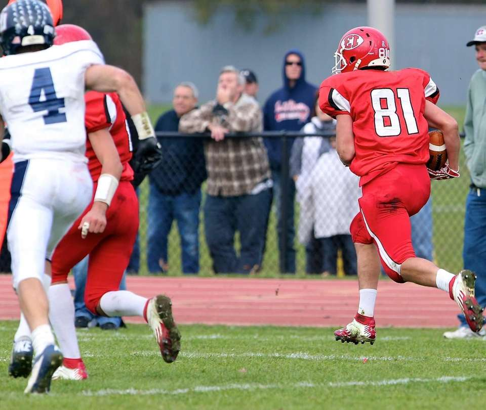 East Islip's Mike Lee takes the interception to