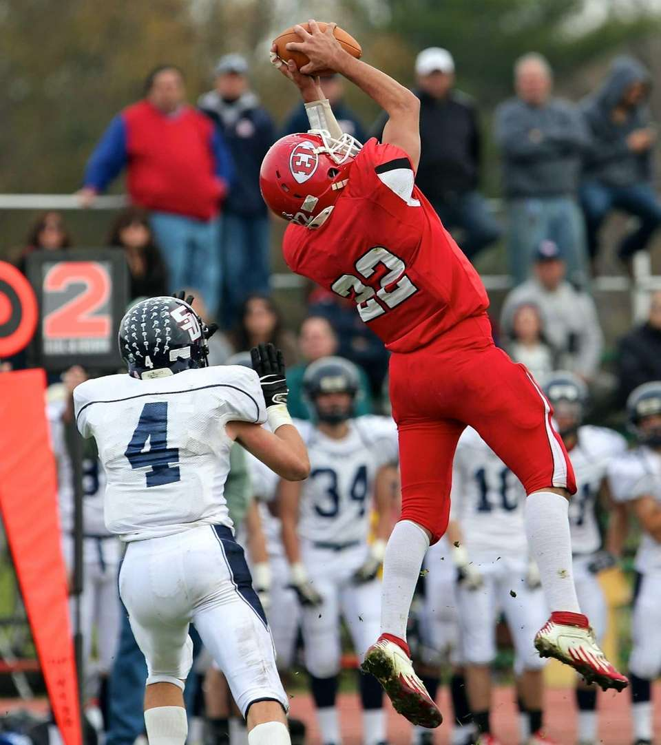 East Islip's Paul Dondero leaps for the pass,