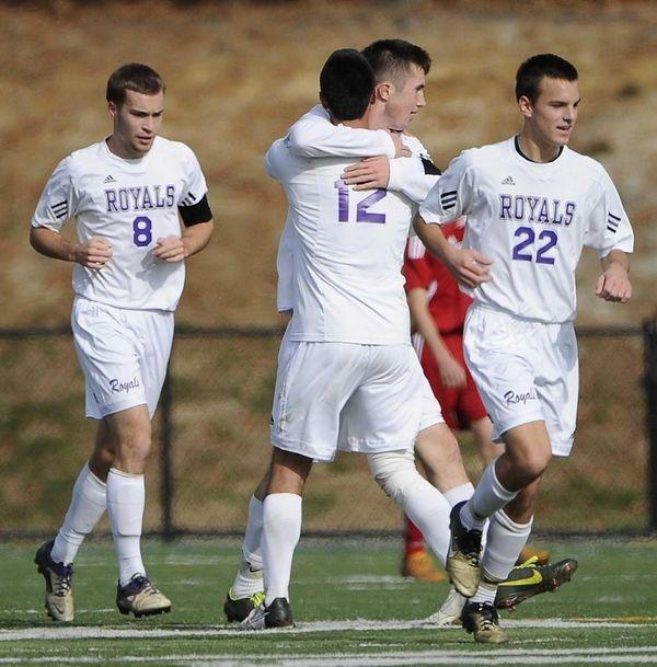 Port Jefferson's Vincent Antonelli embraces teammate Blake Bohlen