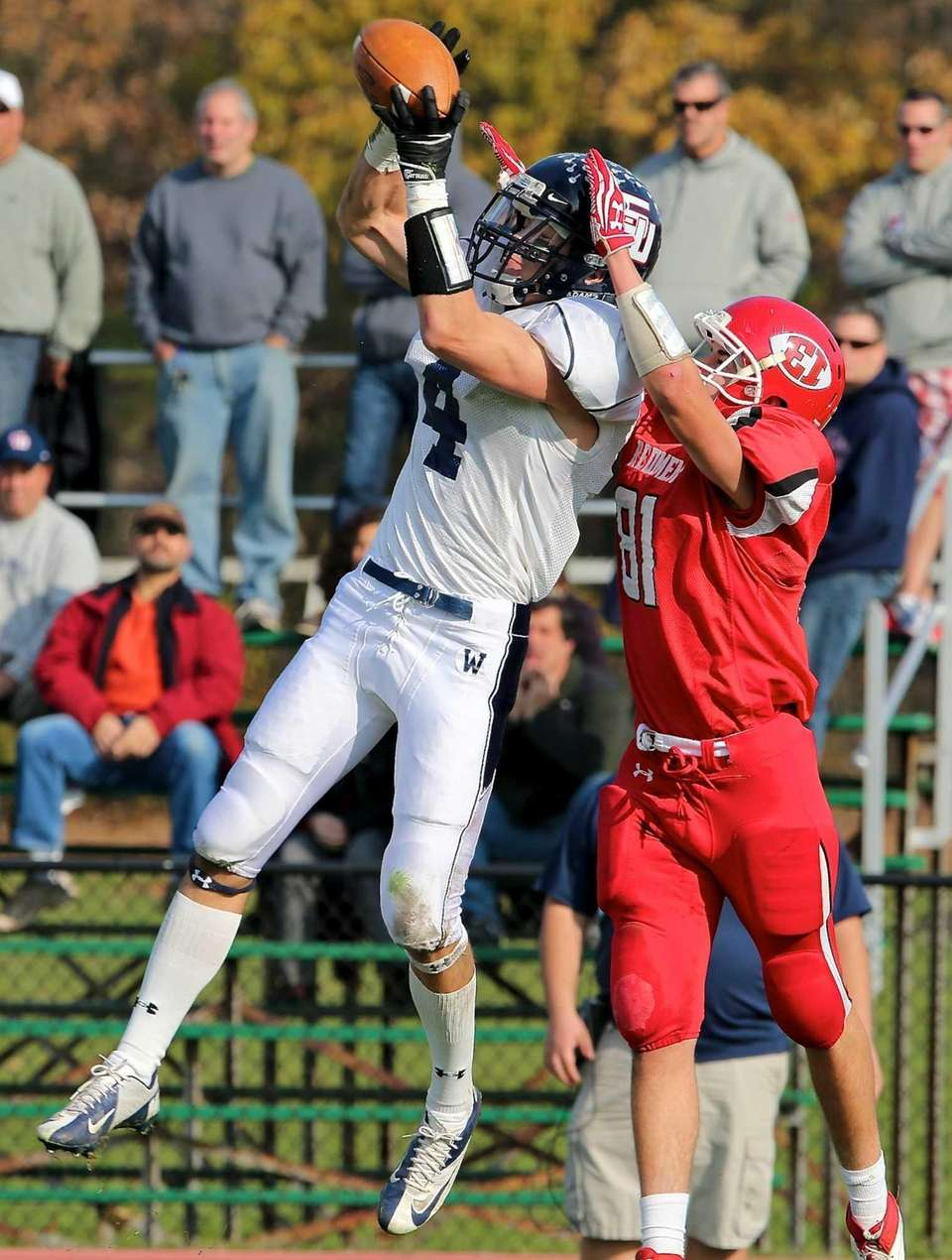 Smithtown West's Kyle Mathie almost intercepts the pass
