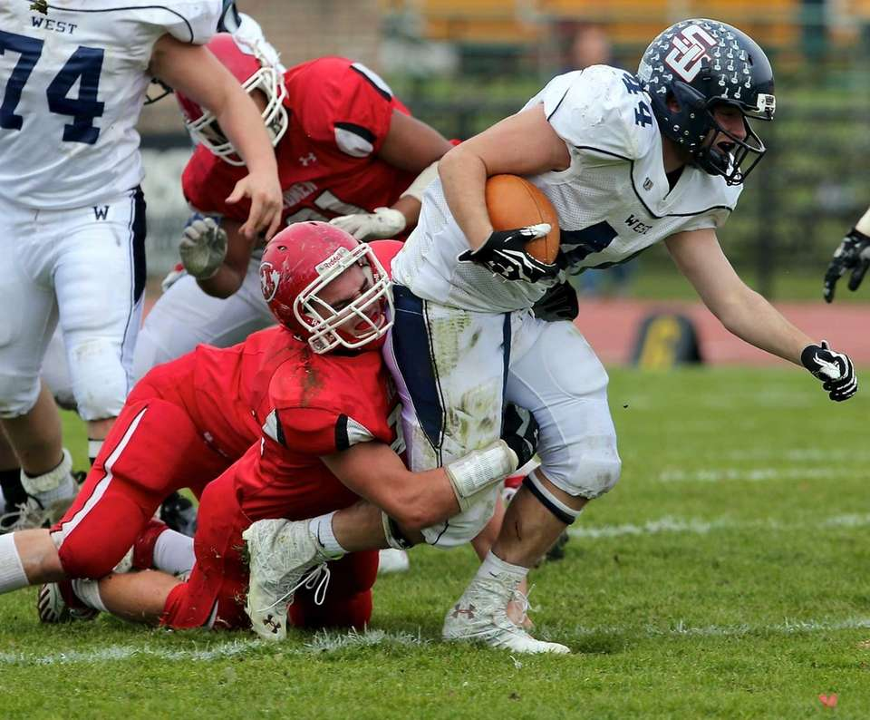 Smithtown West running back Logan Greco is taken