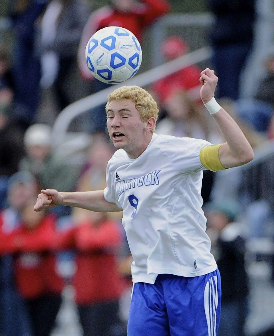 Mattituck's David Burkhardt heads the ball against Center