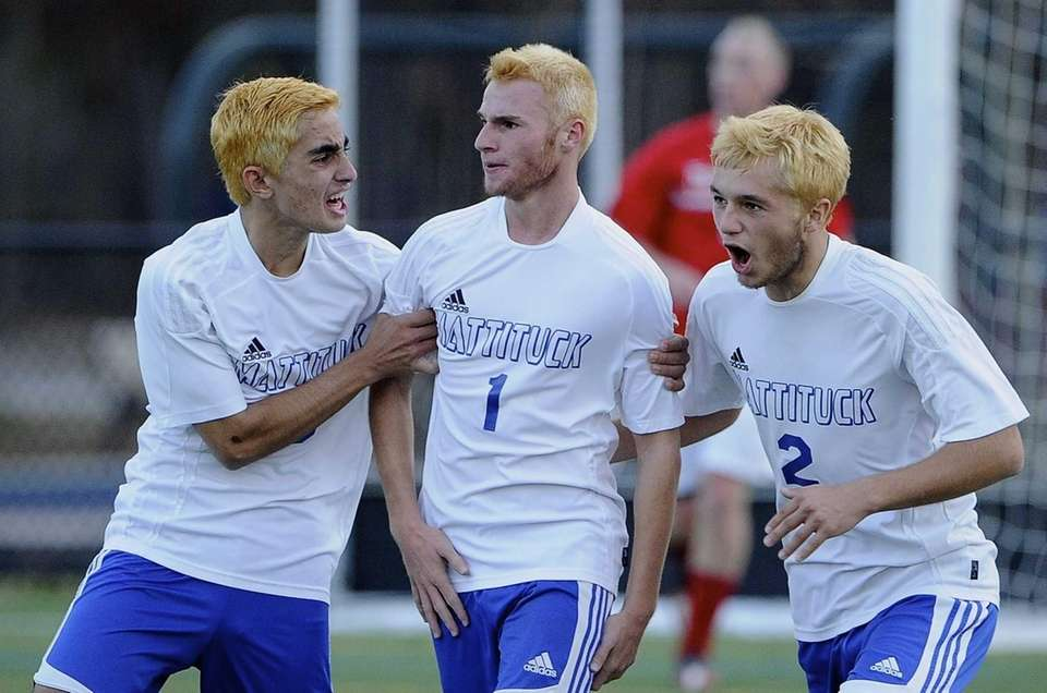 Mattituck's Stephen Urwand, center, is congratulated by Kaan