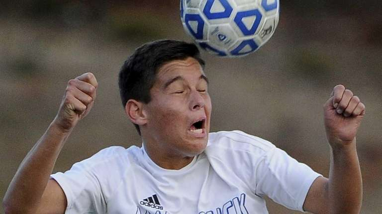 Mattituck's James Hayes the ball against Center Moriches