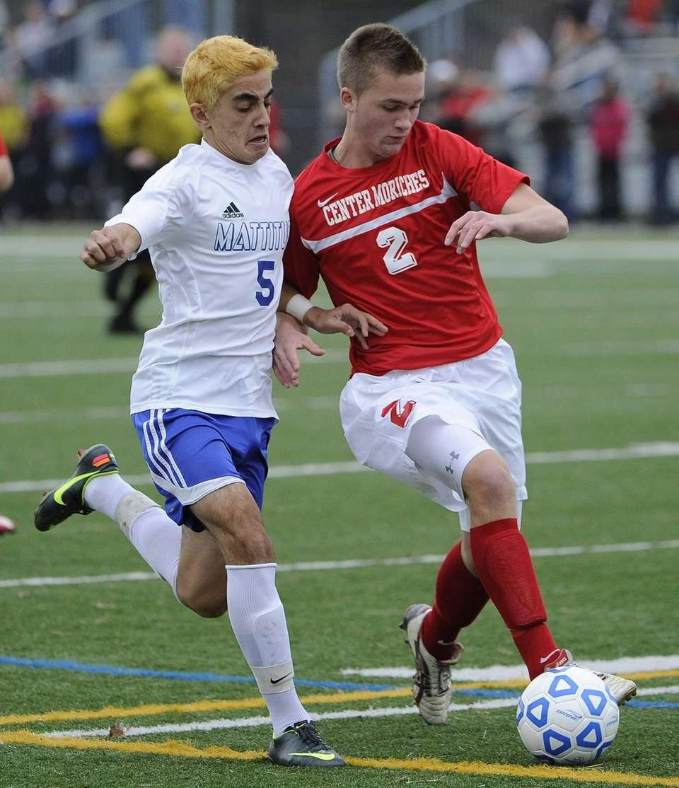 Mattituck's Kaan Ilgin is defended by Center Moriches's