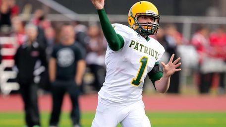 Ward Melville quarterback Jake Biro drops back to