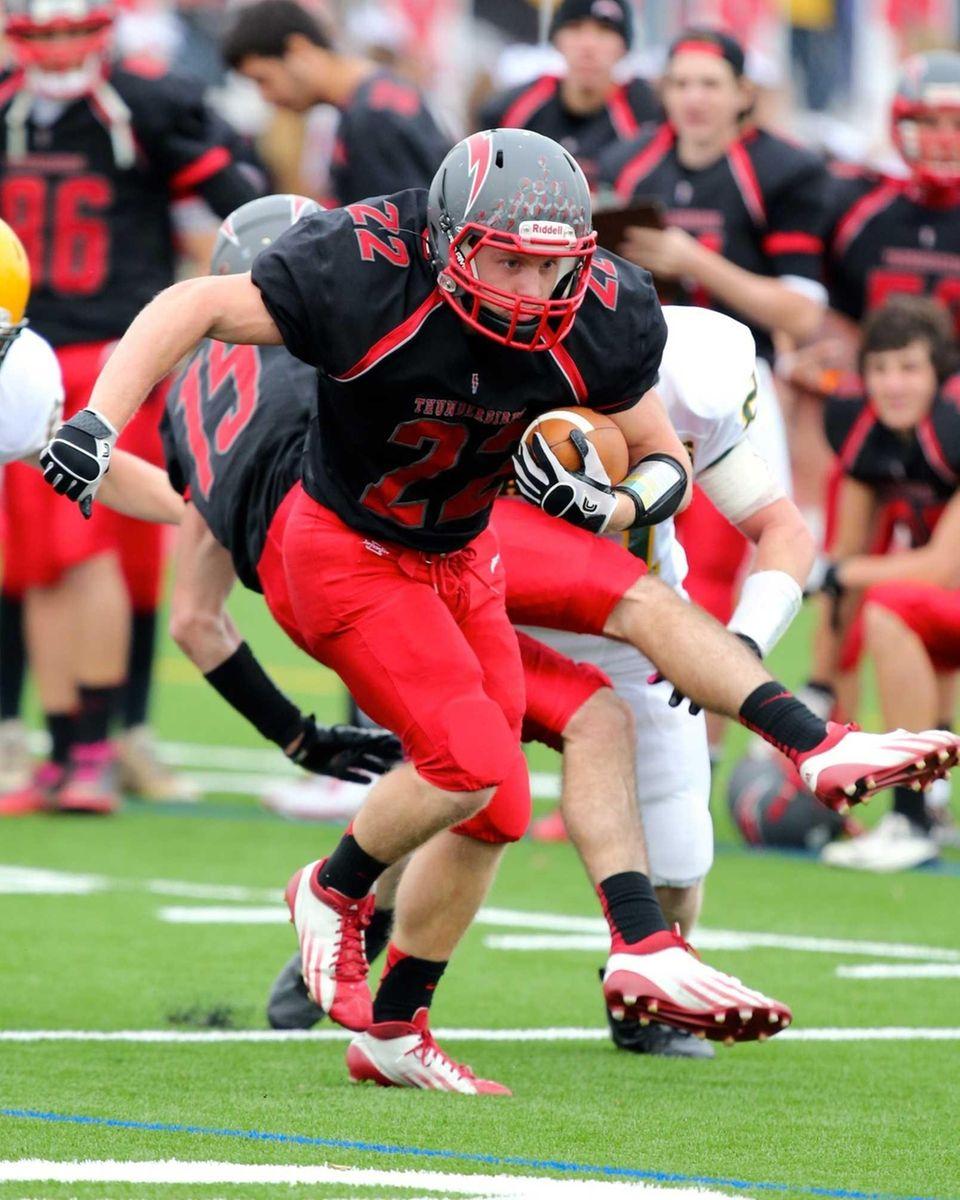 Connetquot's Ryan Harvey drives toward the goal line