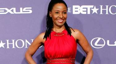 B. Smith arrives at the BET Honors red