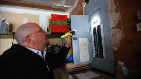 An electrical inspector hired by LIPA inspects the