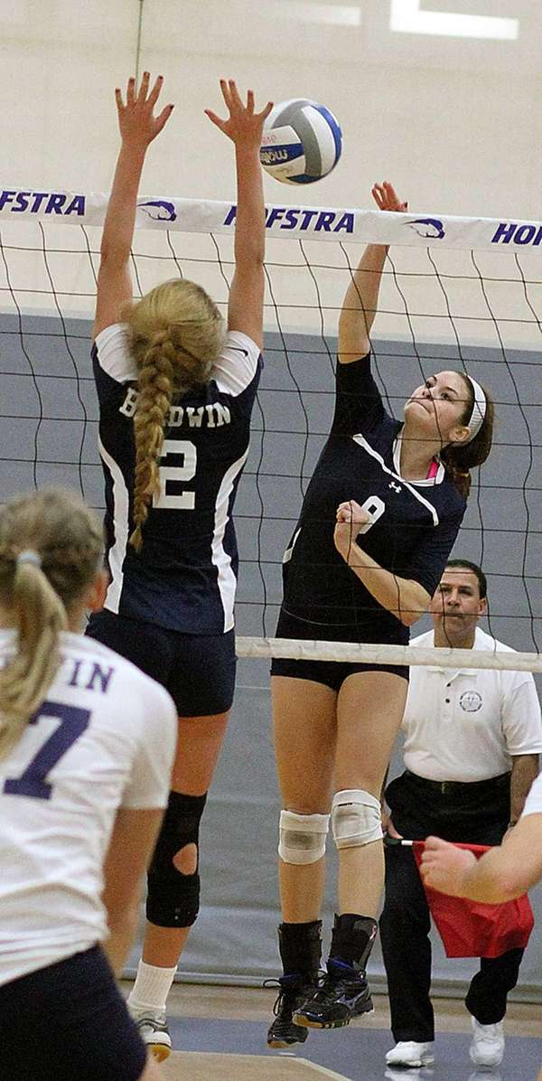 Massapequa's Justine Abbate goes for the spike during