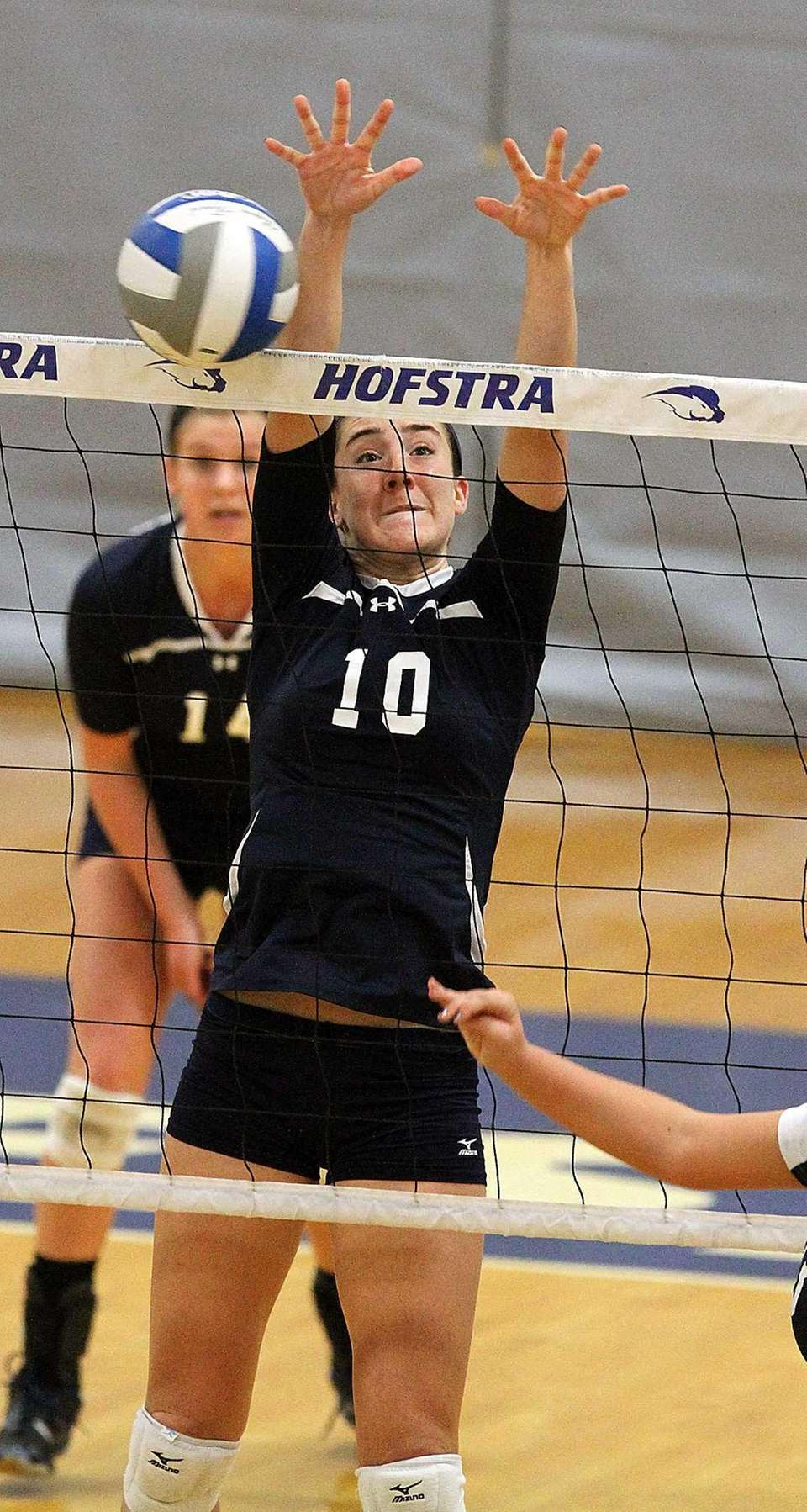 Massapequa's Kathryn Maisch goes for the block during