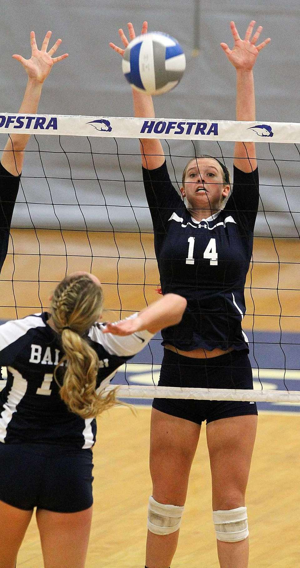 Massapequa's Lauren Van Buren goes for the block