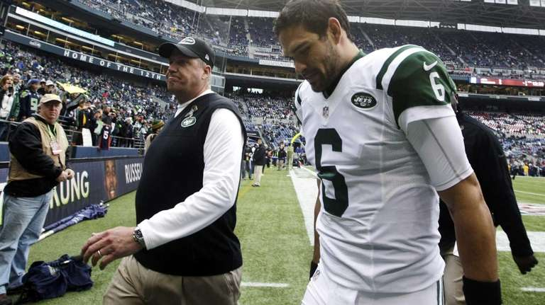 Jets head coach Rex Ryan, left, walks off