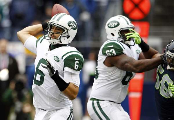 Jets quarterback Mark Sanchez throws a pass as