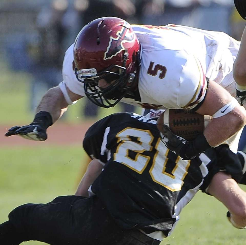 Sachem East's Steven Casali is tackled by Northport's