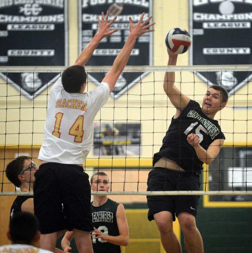 Lindenhurst's Kenny Serwan spikes the ball while Sachem