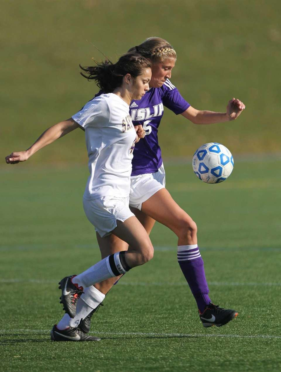 Sayville's Madison Hoon and Islip's Amanda Buck battle