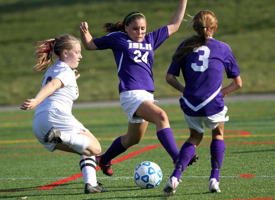 Sayville's Elizabeth Koehler joins Islip's Brooke Skahan, center,