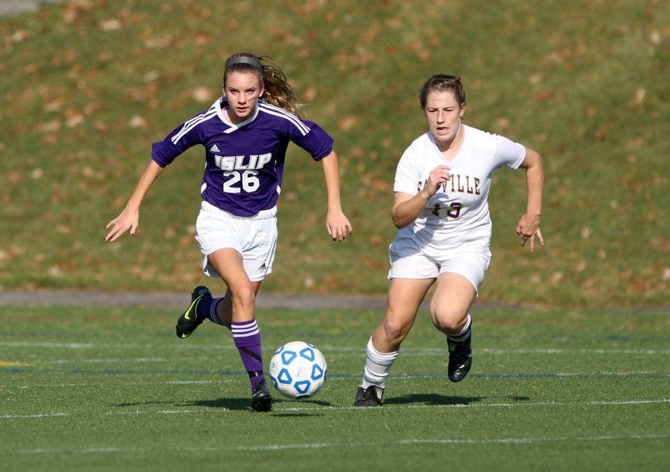 Islip's Julia Celentano moves the ball upfield ahead