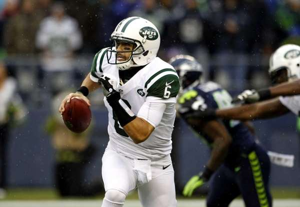 Jets quarterback Mark Sanchez looks to pass during