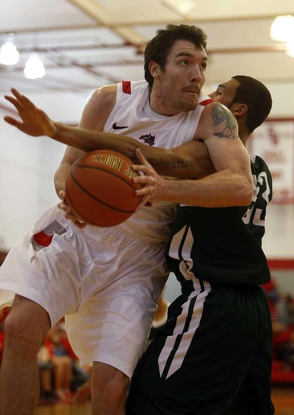 Stony Brook's Tommy Brenton is fouled under the
