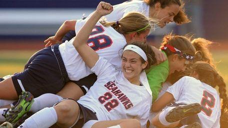 Cold Spring Harbor's Teressa Fazio and teammates celebrate