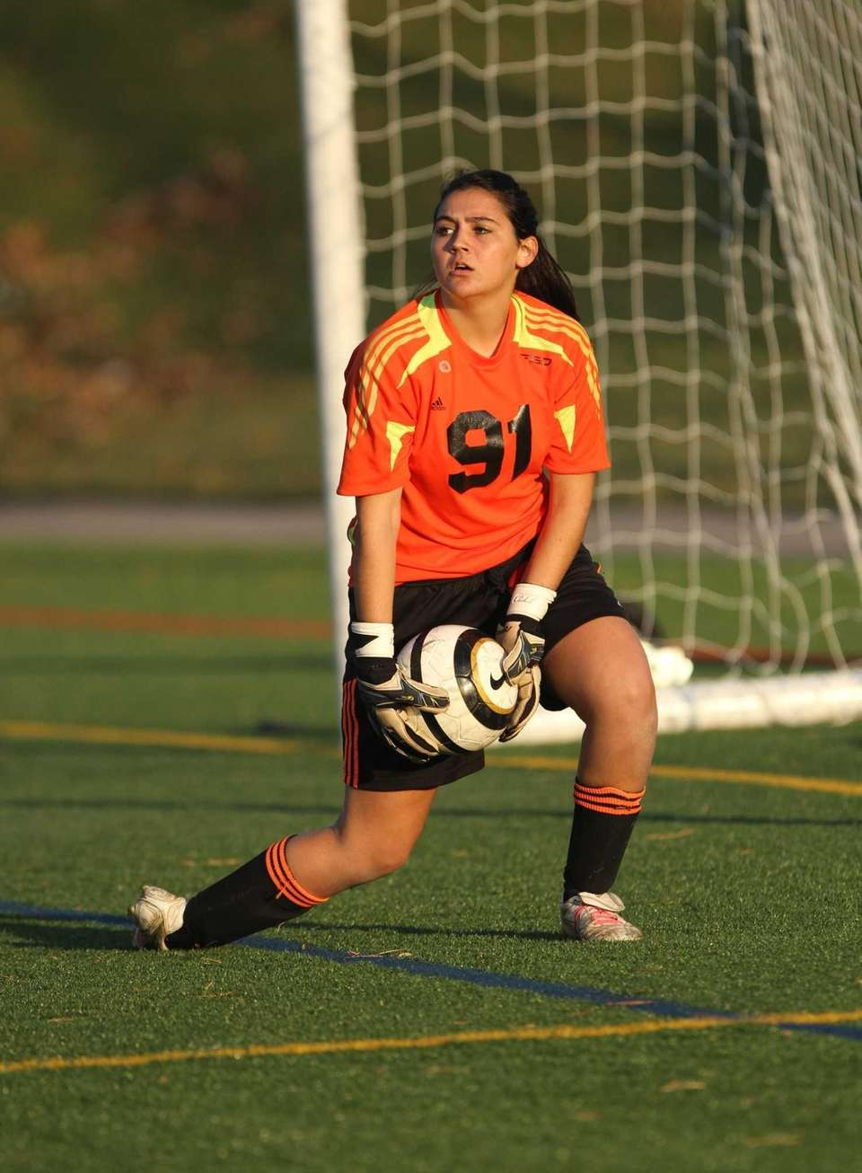 Northport goalkeeper Jessica Rom controls the ball after