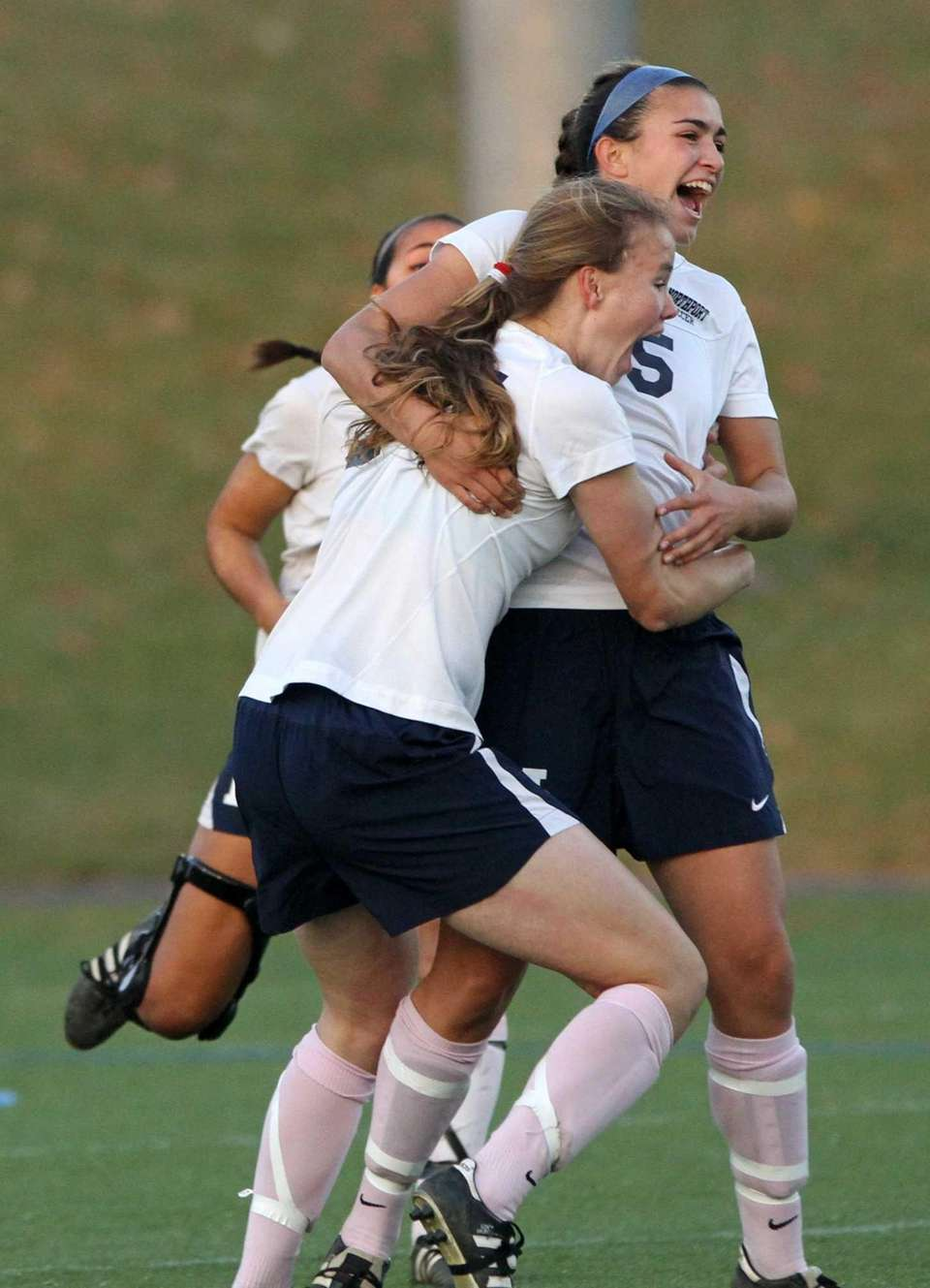 Northport's Cortney Fortunato (blue headband) celebrates with her