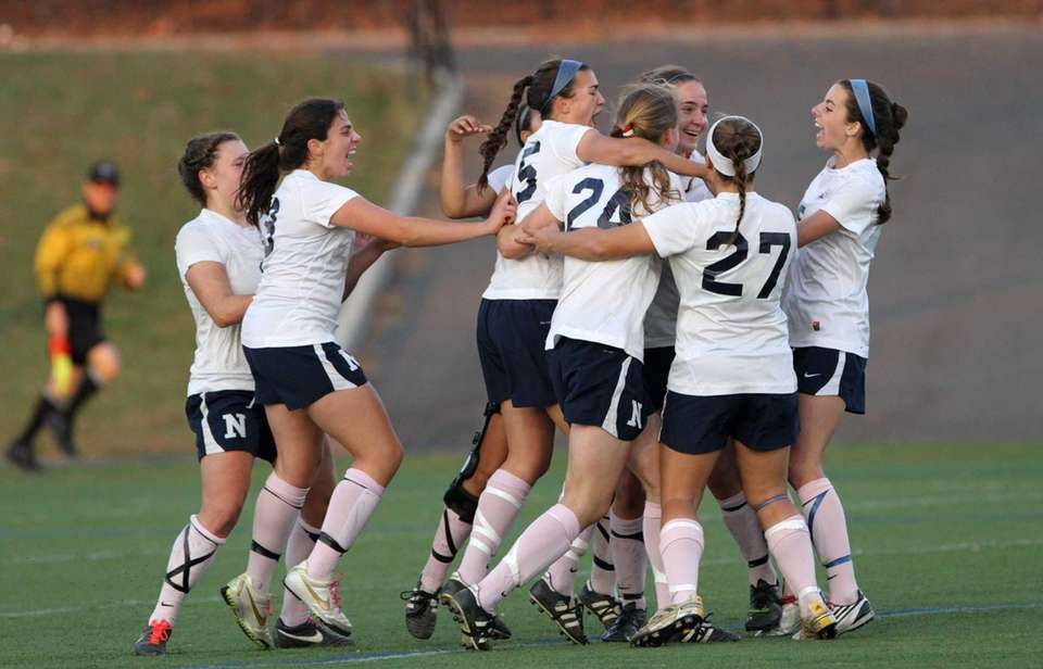 Northport players celebrate after defeating Ward Melville, 1-0,