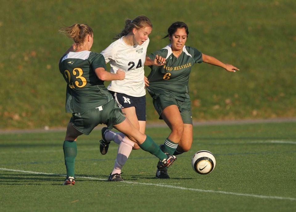 Northport's Natasha Albaneze tries to squeeze between Ward