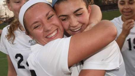 Northport's Cortney Fortunato, right, is embraced by teammate
