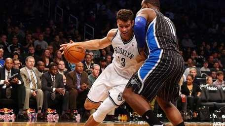 Kris Humphries #43 of the Nets drives against