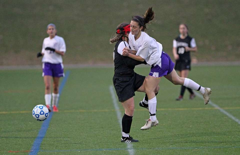 Port Jefferson's Demitria Ulino collides with Friends Academy's
