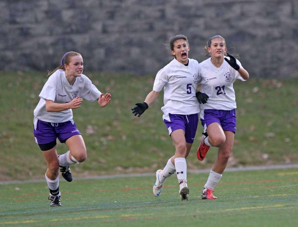 Port Jefferson's Olivia Racanelli, center, celebrates with teammates
