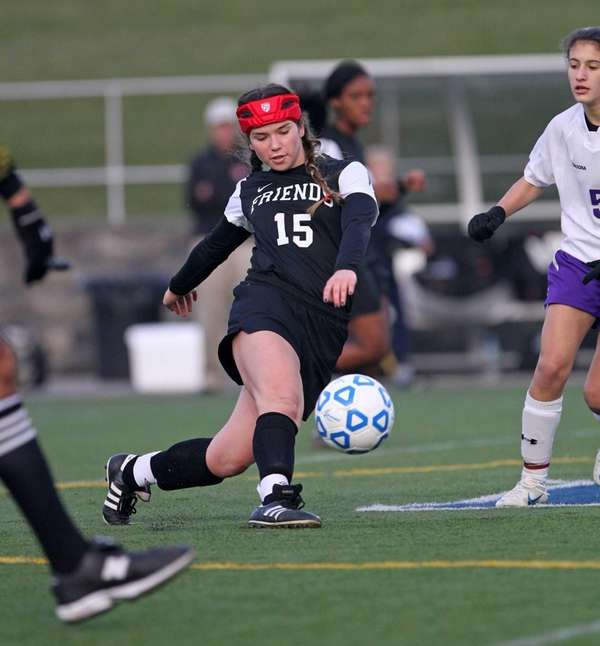 Friends Academy's Kasey Katz passes the ball in