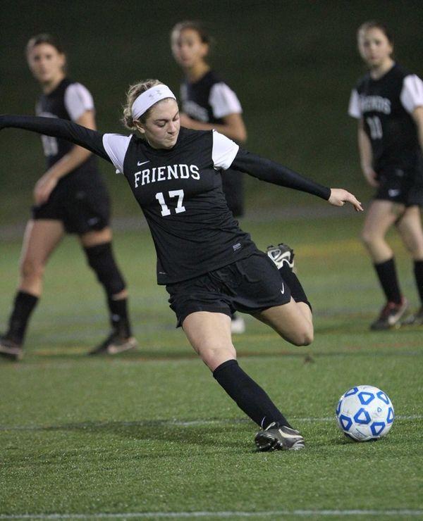 Friends Academy's Krystina Iordanou clears the ball in